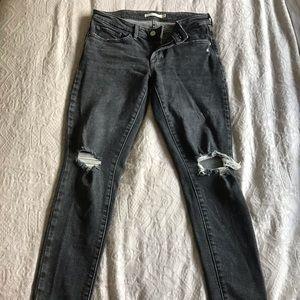 Levi's 711 skinny jeans in black.